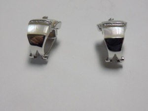 Pair of 14 White Gold Buckle Design Half Hoop Clip-On Earrings; Each Holds Mother-Of-Pearl and Small Diamonds; Weigh 5.3 Grams. Excellent Condition.