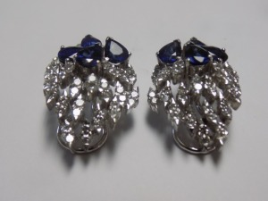 Pair of 18 Karat White Gold Cluster Clip-on Earrings with Four Pear Shaped Blue Sapphires and Forty Diamonds in each which Weigh an Estimated 2.40 Carats Together and are (VS2-S11) Clarity and (G-H) Color. The Earrings Weigh 11.7 Grams and are in Excellen