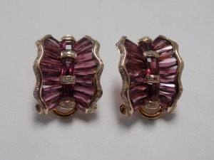 Pair of 14 Karat Yellow Gold Curved Wavy Design Clip-on Earrings holding Rhodolite Garnets and Small Diamonds in each. The Earrings are in Very Good Condition. Weigh 5.0 Grams.