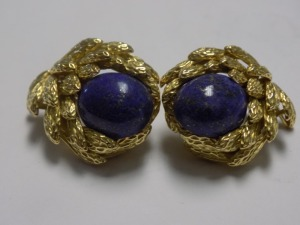 Pair of 18 Karat Yellow Gold 28 mm Long Textured Leaf Design Clip-on Earrings holding an Oval Blue Lapis in Each; the Earrings are in Excellent Condition and Weigh 21.4 Grams.