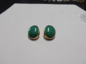 Pair of 14 Karat Yellow Gold Clip-on Earrings Holding an Oval Banded Green Malachite in Each; the Earrings Weigh 10.2 Grams and are in Excellent Condition.