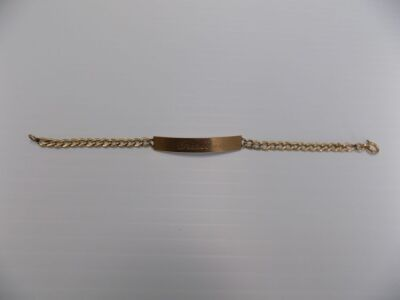 One 14 karat yellow gold child's size identification bracelet engraved 'Christina'; it is in very good condition and weighs 3.2 grams