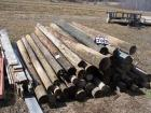 Pile of wooden fence posts, all sizes