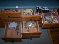 Contents of island drawers, cabinet hardware, misc office.